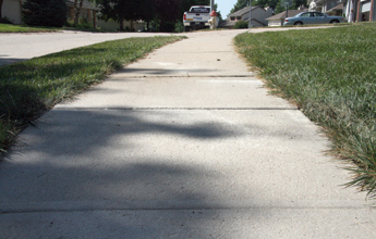 Sunken sidewalk raised with PolyLevel®